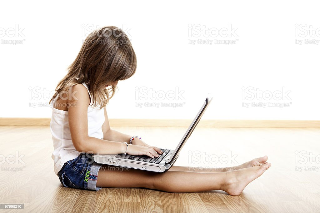 Child playing with a laptop royalty-free stock photo