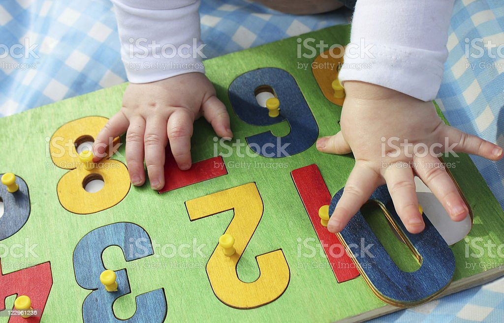 child playing with a number puzzle stock photo