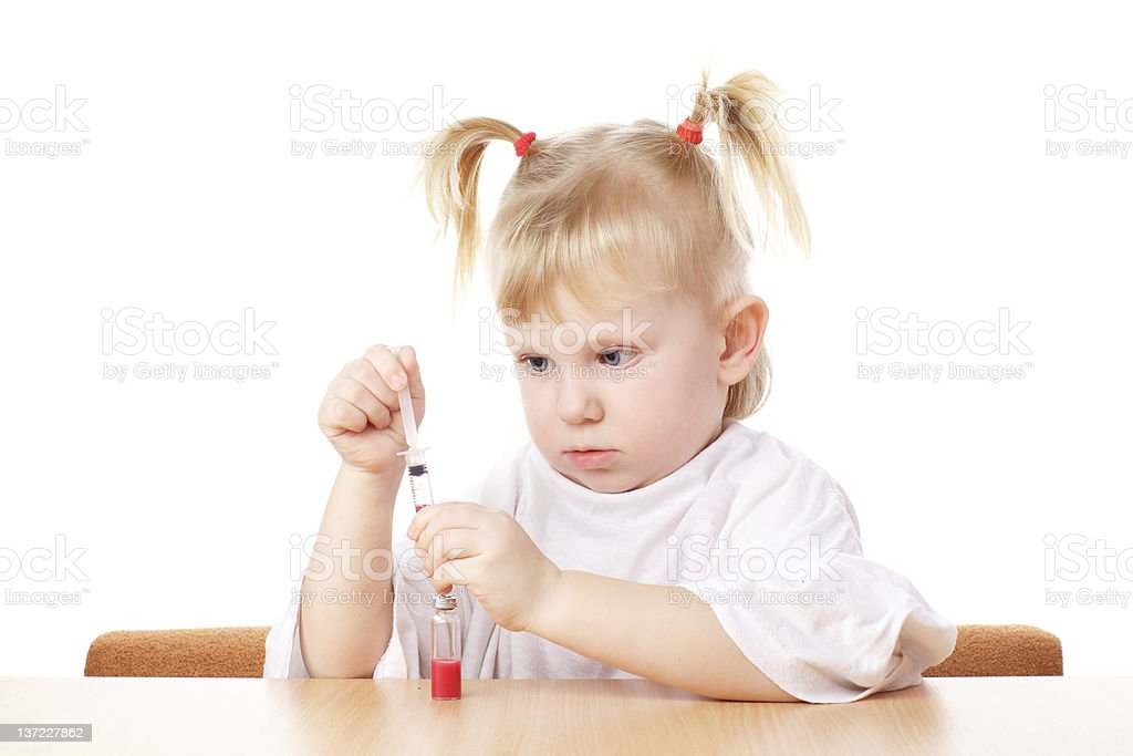 child playing with a syringe royalty-free stock photo