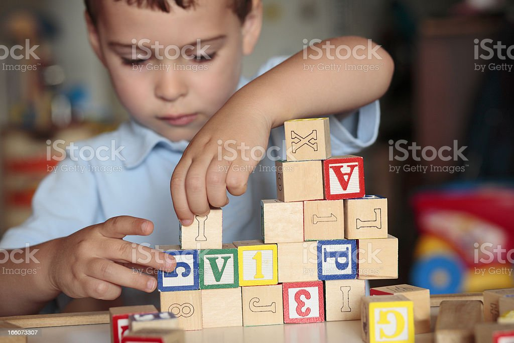 Child playing with blocks royalty-free stock photo