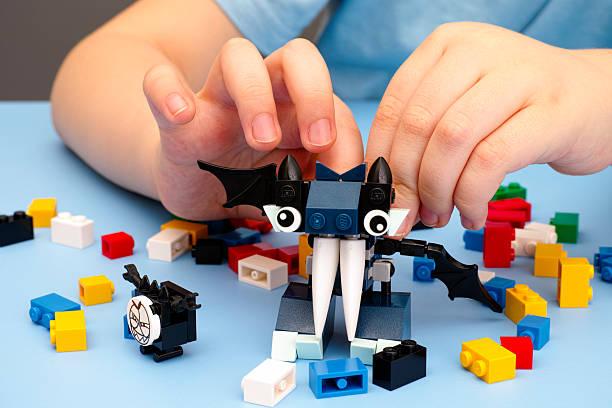 child playing with lego mixel vampos - lego stockfoto's en -beelden