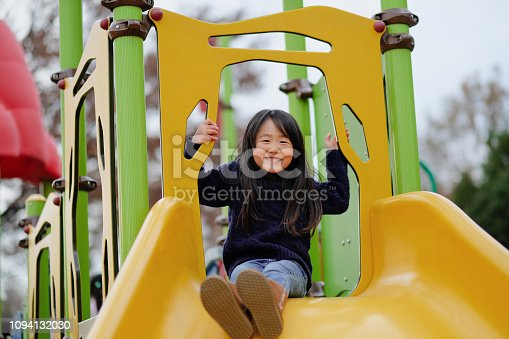 Girl playing alone in park