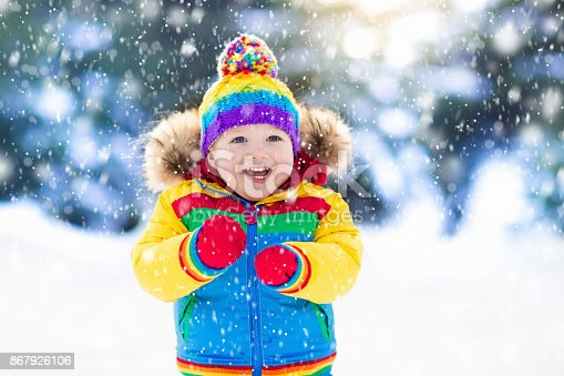 istock Child playing with snow in winter. Kids outdoors. 867926106