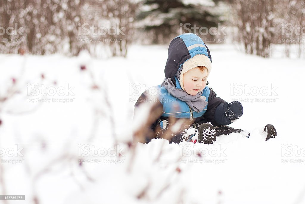 Child playing with snow royalty-free stock photo