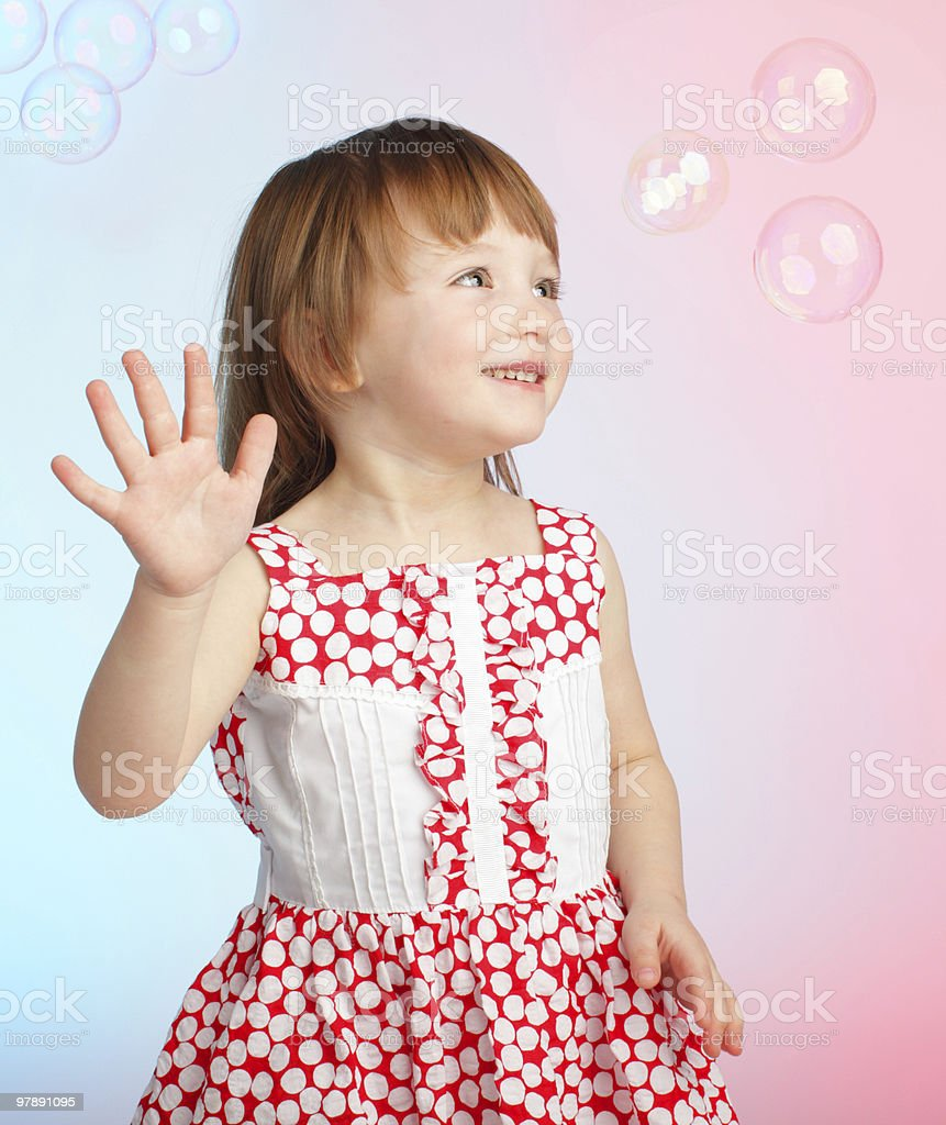 Child playing with soap bubbles royalty-free stock photo