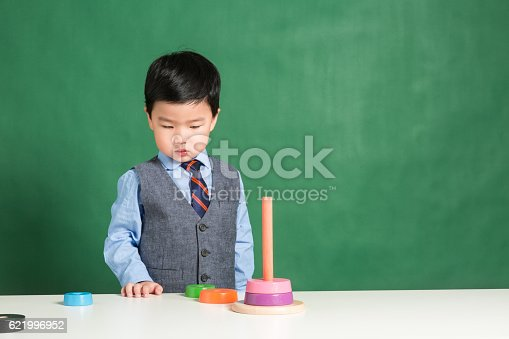 istock Child playing with stacking ring Toy 621996952