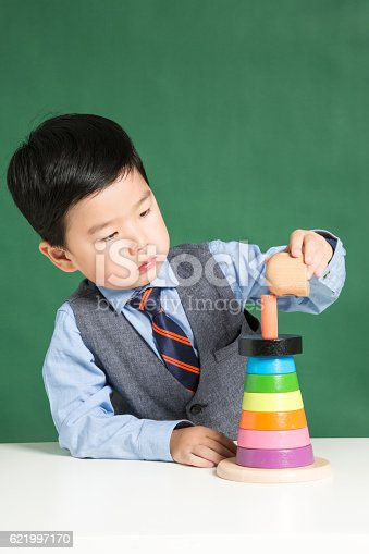 istock Child playing with stacking ring Toy 621997170