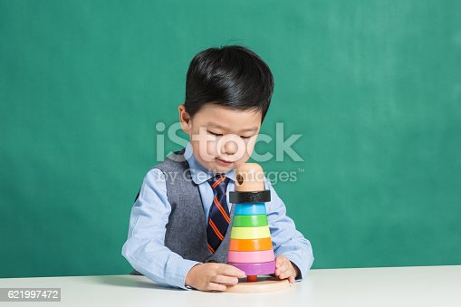 istock Child playing with stacking ring Toy 621997472