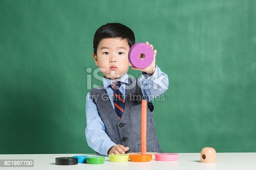 istock Child playing with stacking ring Toy 621997700