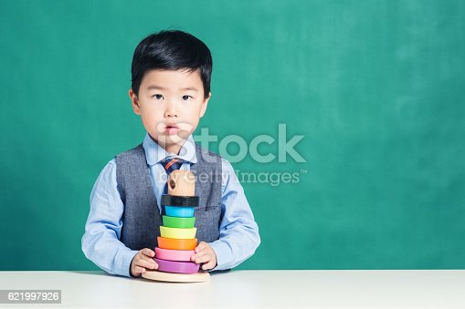 istock Child playing with stacking ring Toy 621997926