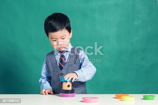 istock Child playing with stacking ring Toy 621998202