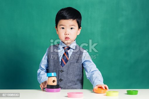 istock Child playing with stacking ring Toy 621998530
