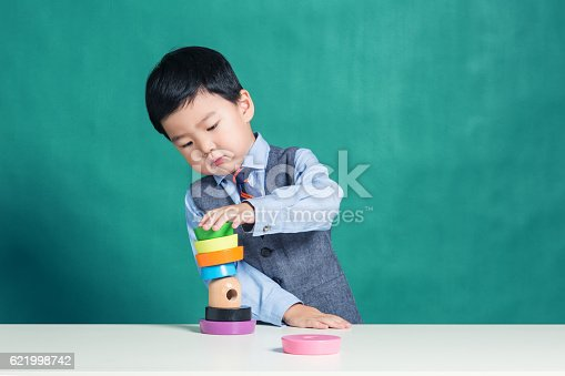 istock Child playing with stacking ring Toy 621998742