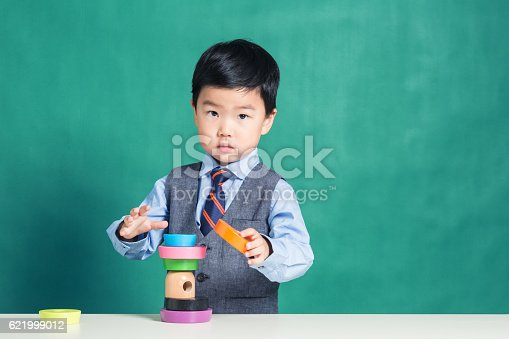istock Child playing with stacking ring Toy 621999012