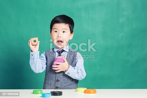 istock Child playing with stacking ring Toy 621999398