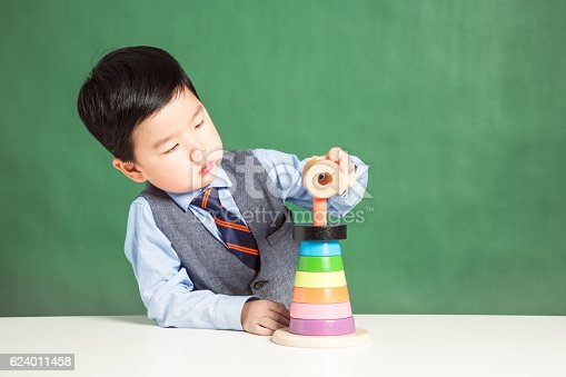 istock Child playing with stacking ring Toy 624011458