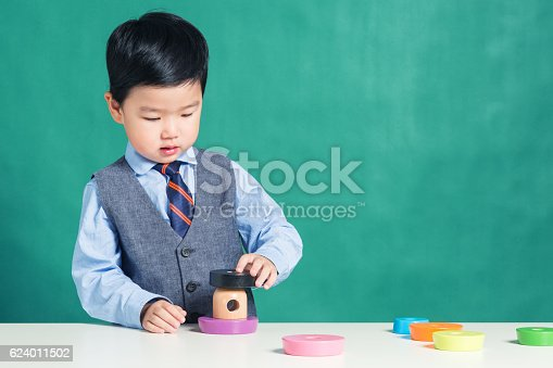 istock Child playing with stacking ring Toy 624011502