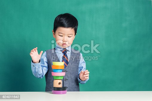 istock Child playing with stacking ring Toy 624011542