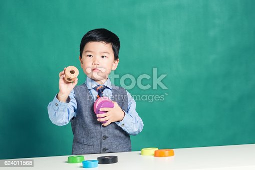 istock Child playing with stacking ring Toy 624011568