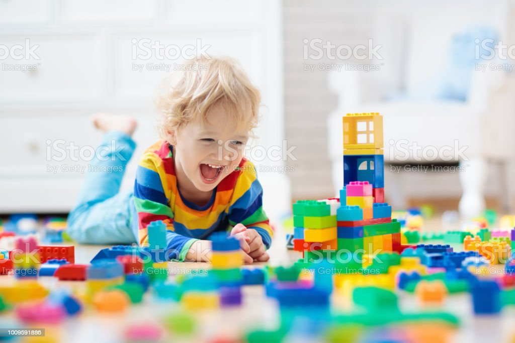 Child playing with toy blocks. Toys for kids. royalty-free stock photo