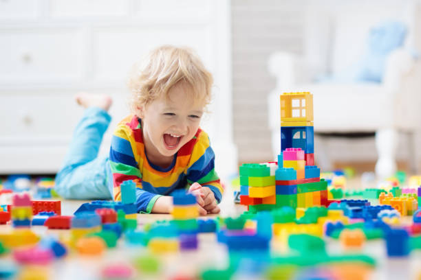 Child playing with toy blocks. Toys for kids. stock photo