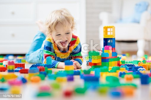 istock Child playing with toy blocks. Toys for kids. 1079797352
