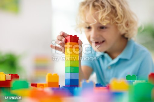 648139780 istock photo Child playing with toy blocks. Toys for kids. 1181283606