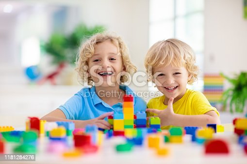 648139780 istock photo Child playing with toy blocks. Toys for kids. 1181284276