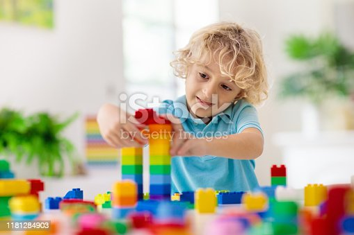 648139780 istock photo Child playing with toy blocks. Toys for kids. 1181284903