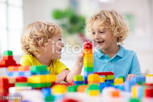 648139780 istock photo Child playing with toy blocks. Toys for kids. 1181286182