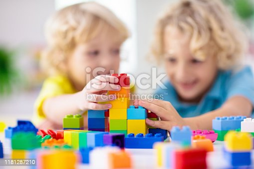648139780 istock photo Child playing with toy blocks. Toys for kids. 1181287210