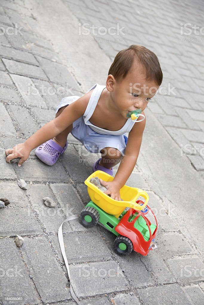 Child playing with toy car royalty-free stock photo