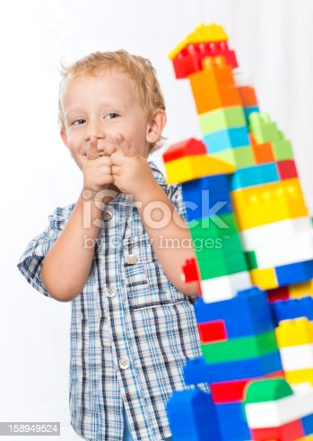 istock Child playing with toys 158949524