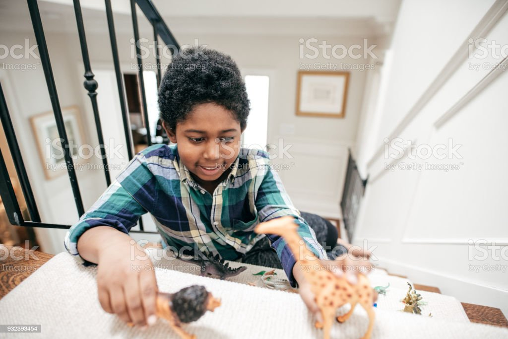 Child playing with toys stock photo