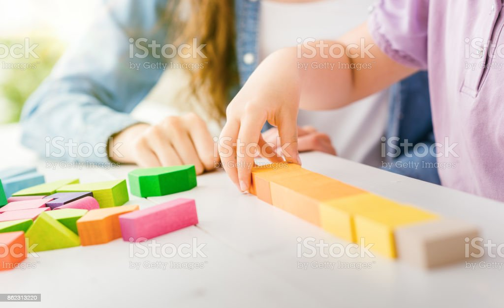 Child playing with wood blocks stock photo