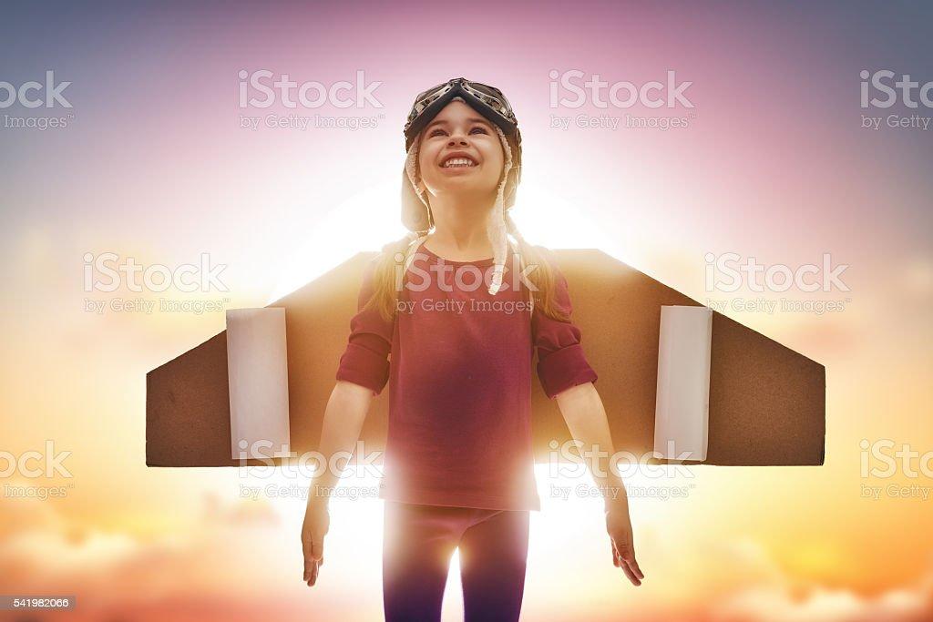 child plays astronaut stock photo