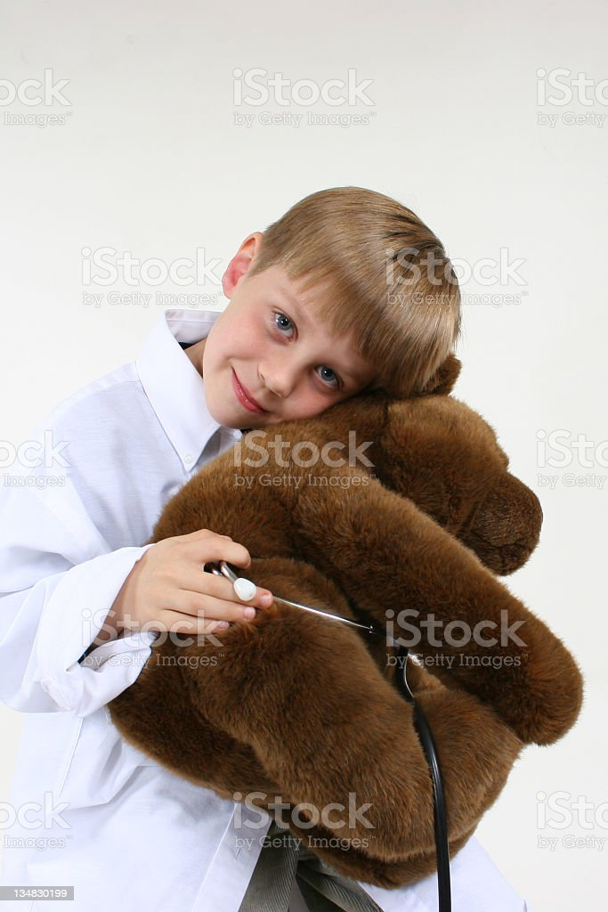 Child plays doctor with teddy bear. royalty-free stock photo