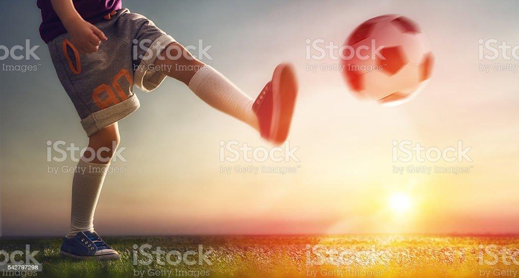 Child plays football stock photo