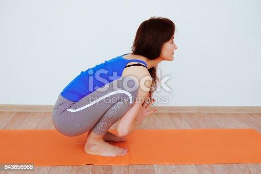 istock Mujer joven en yoga asana - postura de puente. Mujer con cabello  largo y · istock Postura del niño f750292682a1