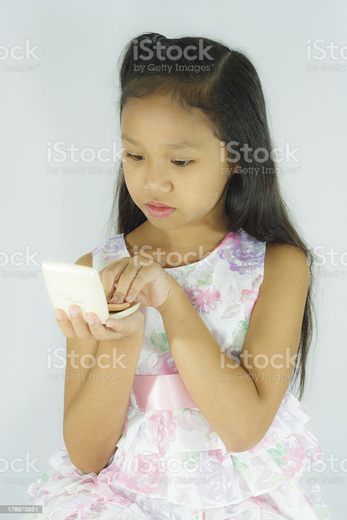 Child powdered makeup. royalty-free stock photo