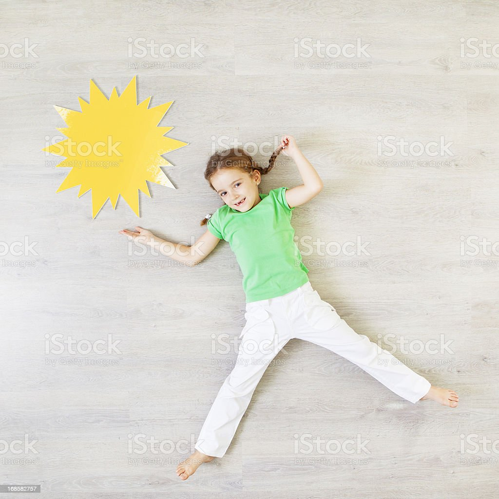 Child Presenting Sunny Weather. stock photo