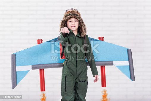 620402800istockphoto Child pretending to fly with jet pack 1125213692