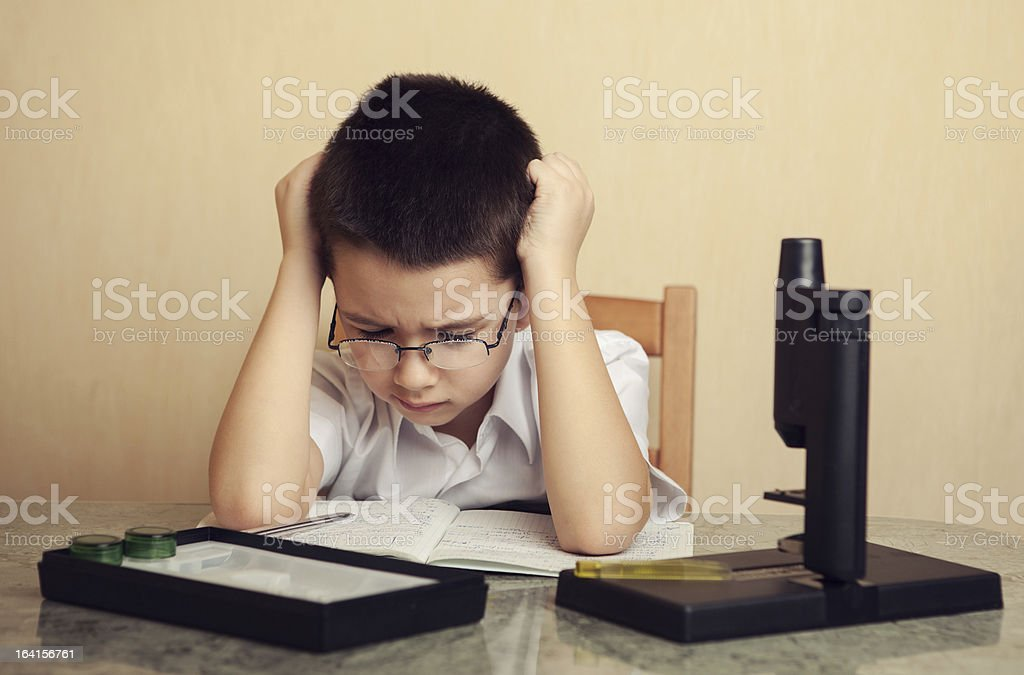 Child prodigy is  ponder over a problem stock photo