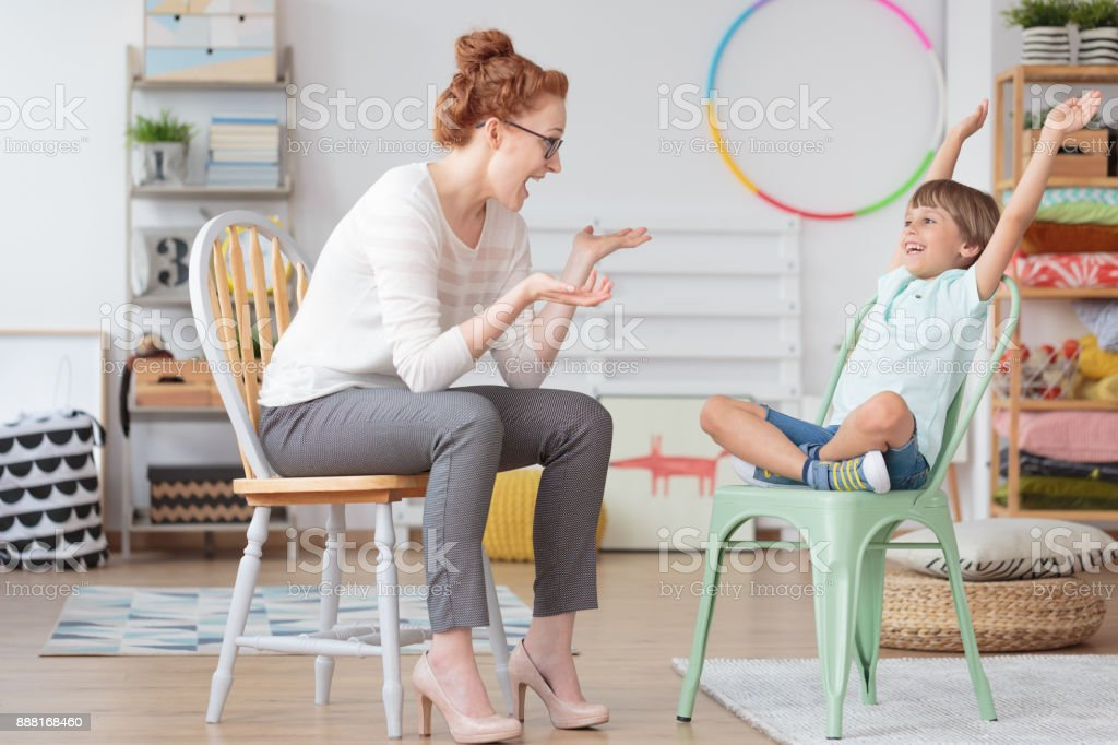 Child psychologist and ADHD kid stock photo