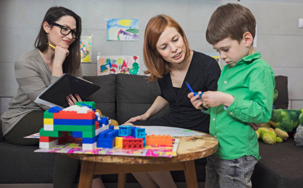 Child psychologist at work Child psychologist at work alternative therapy stock pictures, royalty-free photos & images