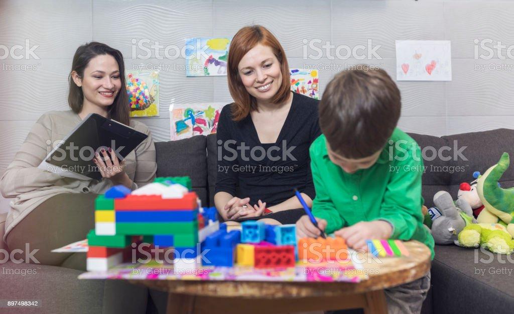 Child psychologist at work stock photo