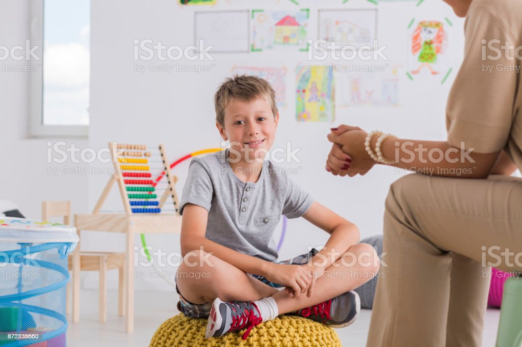 Child psychologist concept, little boy stock photo