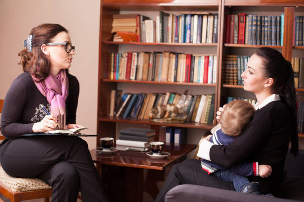 child psychologist the mother with child - school counselor stock photos and pictures