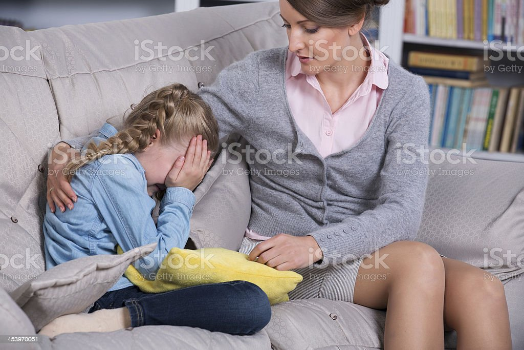Child psychologist with a little girl stock photo