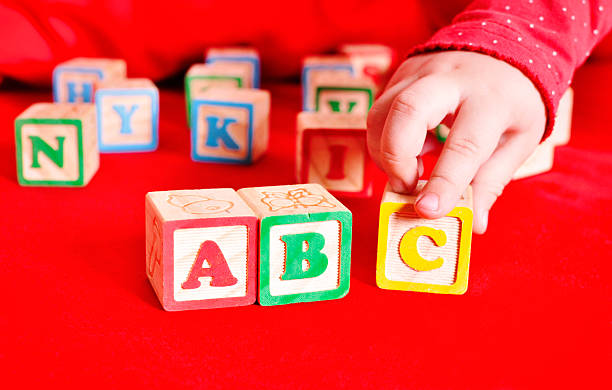 child puts cubes abc - alphabetical order stock pictures, royalty-free photos & images